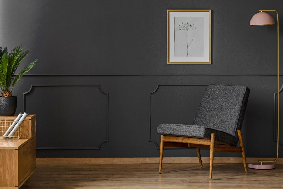 dark black gray wall with chair
